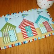 Beach Huts Mug Rug - via @Craftsy