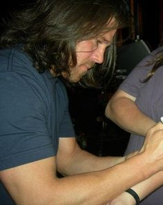 Christian signing a fans arm
