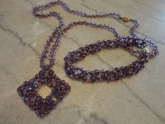 Dynamic Diamonds in purples with gold, pattern from Bead & Button Feb12 by Karla Krohn