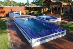 The blue tile really completes the aquatic theme of this Endless Pool + hot tub combination backyard: http://www.endlesspools.com/