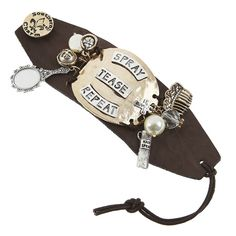 "BRACE YOURSELF: This ""Spray, Tease and Repeat"" button hook bracelet features faux leather with metallic charms."