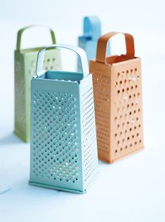 Spray paint old graters and place candles inside.  Fun way to cheer up a patio!