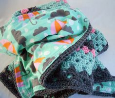 Crocheted blanket with umbrella fabric lining. Too cute!