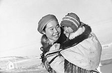 Inuit mother and child at Port Harrison, Quebec, ca. 1947 or 1948. Photographer: Richard Harrington. Library and Archives Canada, PA-147049