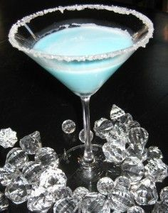 Silent Night Martini!: 1/4 c. Malibu Rum, 1/4 c. pineapple juice, 1/8 c. blue curacao, 1/8 c. white creme de coacoa, dash or two of whipping cream~ rim a martini glass with sugar, add all ingredients with ice- shake and pour! #drinks #cocktails #drinkrecipes