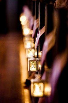 mini lanterns on pews