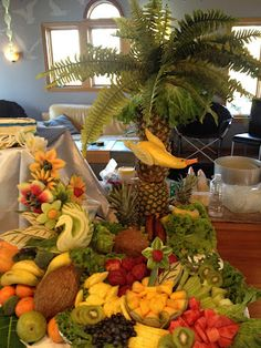 "a whole fruit display scene. LOVE the duck ""flying"" next to the pineapple palm tree"