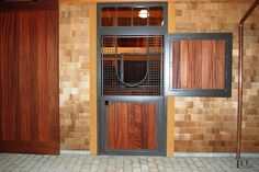 Love the wood in this dutch door. Sapele wood. Great color palette! Horse stalls by Lucas Equine.