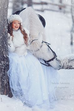 Horse and girl in the winter snow