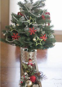 Radiant Rural Centerpiece - To make this DIY Christmas centerpiece really stand out, place a small pine tree in the center and decorate it with garland and ornaments.