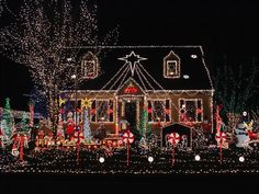 This home went all out but kept it classic. The home, windows and yard were outlined in classic white lights and topped with an extra-large star. The yard was adorned with peppermints, snowmen, reindeer, jingle bells and Christmas trees to tie in everyone's holiday favorites.