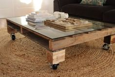 Another easy project is to make a coffee table out of a wooden pallet. Take off the bottom row and cut it down a bit if you don't like the dimensions. Lift up a bit the pallet with some pieces of wood and attach castors. Then put a piece of glass on top of the table and you're done.