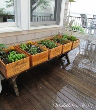 DIY Deck Herb Garden Using Wine Crates so cute and what a neat decor idea for outside!