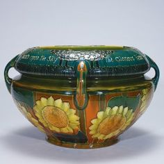 "Massive Avon Faience jardiniere in the style of Frederick Hurten Rhead. A slogan encircling the shoulder between the handles reads ""How Bravely Autumn Paints Upon The Sky The glorious Fame Of Summer Which Is Fled."" vintag american, american art, art potteri, jardinierescach pot"