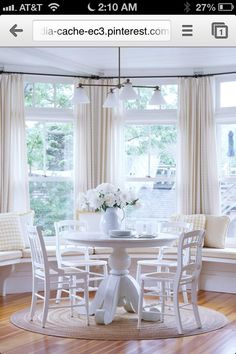 drapes in a bay window with a bench seat