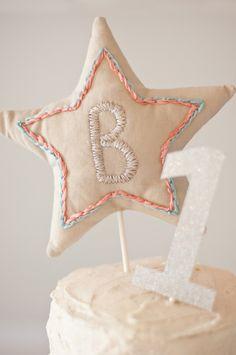 Cute little handmade star cake topper   Photos by Jenni Bailey