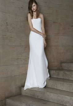 Look 2. Ivory strapless soft mermaid silk crepe gown with cut-out back and cowl detail.
