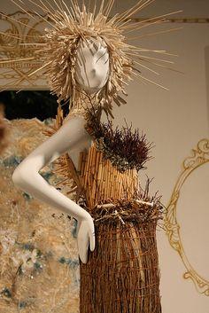 native straw dress, pinned by Ton van der Veer