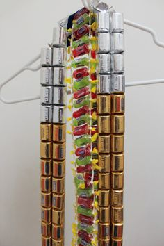 candy lei | Tumblr. No tutorial but for Hershey's lei try double stick tape on ribbon, then press on chocolates, or try duct tape trimmed to width of candies.