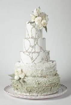 Brides.com: America's Prettiest Wedding Cakes. A Wedding Cake with Fondant Ruffles and Flowers. Maggie Austin paired her signature fondant ruffles with beading inspired by a Jenny Packham wedding gown.  Cake by Maggie Austin, Alexandria, VA  Find a wedding cake vendor in Virginia.