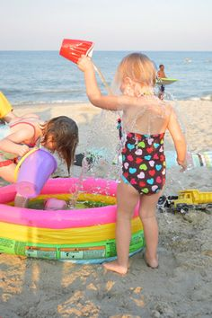 what a great idea... bring an small inflatable kiddie pool to the beach and fill with buckets of water so the kiddos can safely enjoy the water and the beach (and probably have more fun too!)