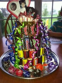 candy bar cake - cute idea for a birthday, gift, table center piece .......