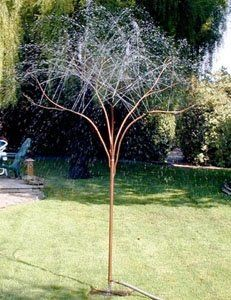 RainTree Sprinklers made out of copper piping. Add some glass for some beautiful yard art! Love this tree!
