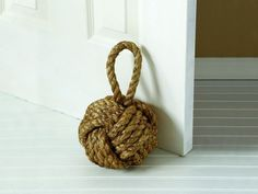 {Knot Door Stopper} these nautical knotted door stoppers are so on trend right now.