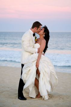 We love the elegant attire of the bride and groom for this beach wedding. Desmond Charles Photography