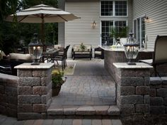 Outdoor kitchens make great spaces for entertaining, plus you'll be the envy of all your neighbors!