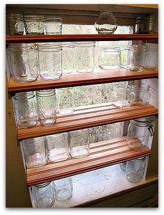 Storage Solutions: store empty canning jars on shelves in pantry window - still lets in light.  Except I would use smooth boards for shelf - those crevices will be hard to clean! canning jar, pantri