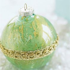 Spatter paint in a clear ornament and add ribbon.