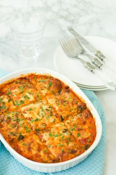 This Spinach and Zucchini Lasagna is vegetarian, low carb and gluten-free. It is made with tomato sauce, skinny ricotta and mozzarela and zucchini noodles. - Primavera Kitchen