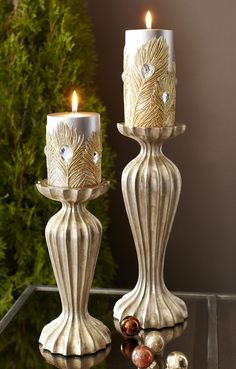 Pier 1 Gold Ribbed Candleholders with Peacock Pillar Candles add unique glamour to the room