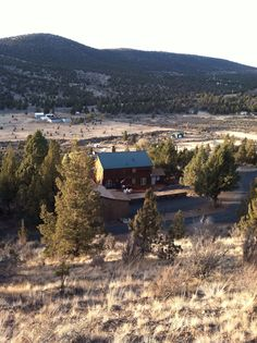 Looking down at the Prineville house after a hike up to Indian Rock at the top end, and highest point, of our property