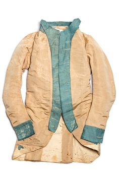 Revolutionary War period uniform coat, c. 1776. It was reputedly worn by General Thomas Pinckney with the 3rd Continental Light Dragoons. Though the use of silk is rare, officers were responsible for their own uniforms, so there would be nothing to restrain an officer from ordering a silk coat.