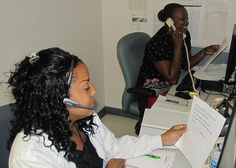 Evelyn Pearson-Stewart (left) and Veneser Bridge process thousands of calls daily using the Automated Call Distribution line. Both ladies are licensed practical nurses who support the Family Health Clinic. (Photo by Marlon J. Martin, McDonald Army Health Center, Fort Eustis, Va.)