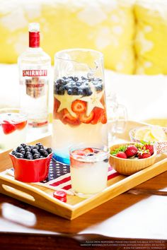 Spark your 4th of July party with this punch. Mix 18 oz Smirnoff Watermelon Flavored Vodka, 4 cups frozen lemonade concentrate, and 2 cups club soda in a large pitcher. Add fresh strawberries, then fresh blueberries to show some patriotism. 12 servings