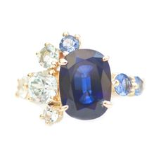 """Mociun Custom Sapphire and Aquamarine Stone Cluster Ring featured in Brides.com article """"Engagement rings with Colorful Stones"""""""
