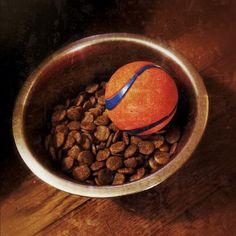 Put a ball in your dog's food bowl if he or she eats too fast.