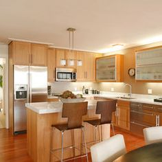 oak cabinets, silver hardware, light counters