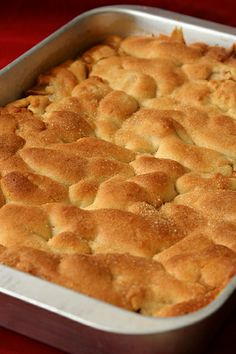 Russian Grandmother's Apple Pie-Cake   For The Dough  2 sticks unsalted butter  1 cup sugar  2 large eggs  1 tablespoon baking powder  ½ teaspoon salt  Juice of 1 lemon  3¼ – 3½ cups all-purpose flour  For The Apples  10 medium apples, all one kind or a mix  Squirt of fresh lemon juice  1 cup moist, plump raisins (dark or golden)  ¼ cup sugar  1¼ teaspoons ground cinnamon   sugar, for dusting