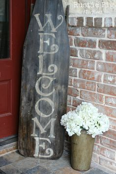 old ironing board welcome sign