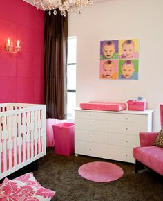 Hot Pink Girl's Nursery    hot pink girl's nursery design with white modern crib, pink walls, sconces, crystal chandelier, white & pink damask pillows, white changing table dresser, chocolate brown silk drapes, pink wingback chair and chocolate brown rug. white pink brown girl's nursery colors.