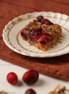 walnut cranberry bars; walnuts tangy cranberries in a rich maple ...