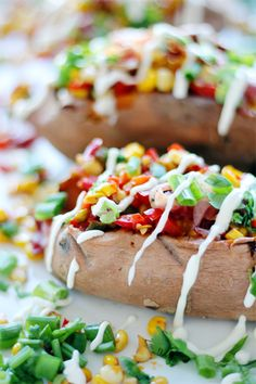 Corn and Scallion Stuffed Sweet Potatoes with Lime Crema