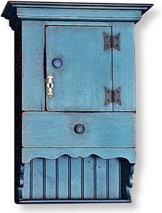 COLONIAL CABINET with DOOR and SHELF IN WEATHERED BLUE PAINT.
