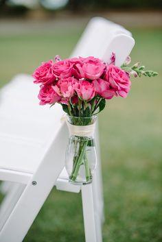 Bright pink chair florals | Photography: Sean Money + Elizabeth Fay - seanmoney-elizabethfay.com  Read More: http://www.stylemepretty.com/2014/05/29/elegant-lowndes-grove-plantation-wedding/
