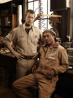 Colin Ferguson as Jack Carter and Joe Morton as Henry Deacon on Eureka.