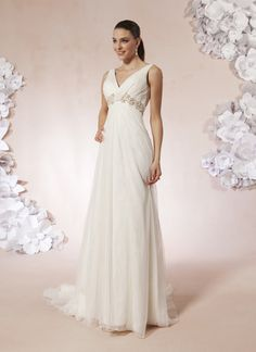 Sweetheart style 5998 A V-neck tank with a twisted knot, accented with beaded trim at the  empire waist on this English net and lace A-line gown. The back has a  Keyhole and a sweep length train.